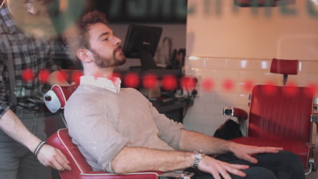 hot towel treatment in gentlemans barber - barber chair stock videos & royalty-free footage