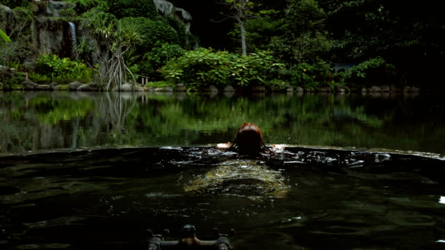 stockvideo's en b-roll-footage met hot tub in de jungle. vrouw ontspannen in wellness retreat - mindfulness