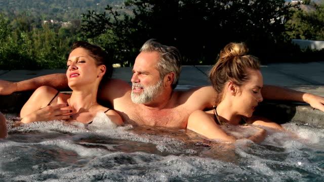hot tub threesome, big laugh - hot tub stock videos & royalty-free footage