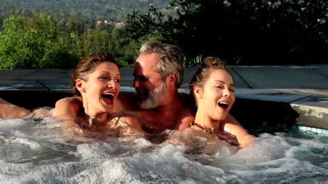 hot tub threesome, let's get closer - one piece swimsuit stock videos and b-roll footage