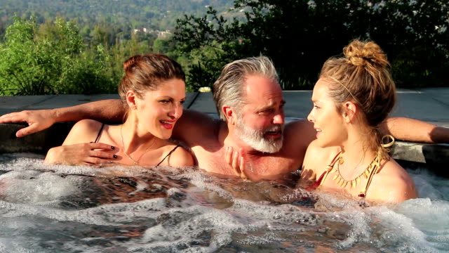 hot tub threesome, what can i say? - hot tub stock videos & royalty-free footage
