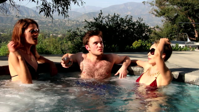 hot tub young threesome, splash! - copulation of humans stock videos & royalty-free footage