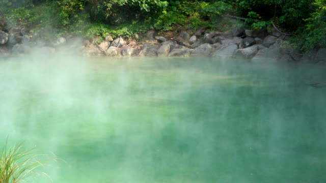 hot water from thermal spring in beitou taipei, taiwan - hot spring stock videos & royalty-free footage