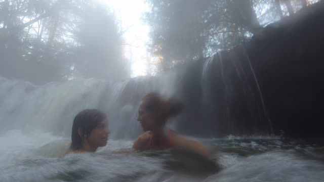 hot water river, a woman and her child swim in a river - hot spring stock videos & royalty-free footage