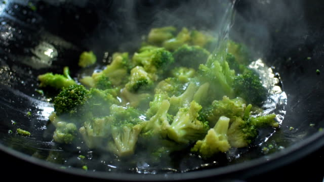 hot wok cooking, slo mo - broccoli stock videos & royalty-free footage
