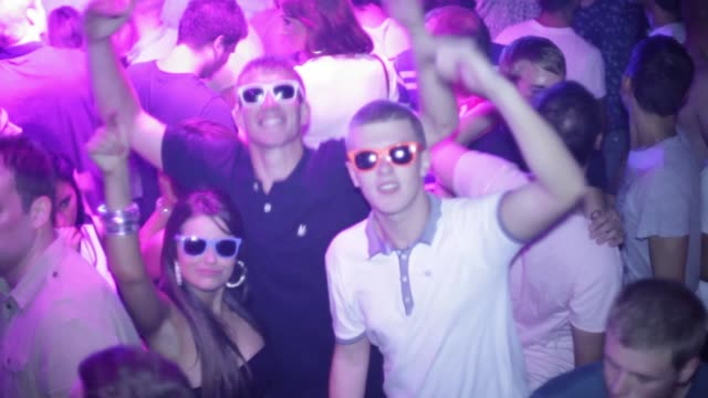hot young attractive young people dancing man male woman girl female nightclub - betrunken stock-videos und b-roll-filmmaterial