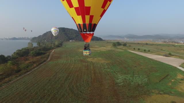 hot-air balloon at gudeurae ferry of geumgang river / buyeo-gun, chungcheongnam-do, south korea - surfacing stock videos & royalty-free footage