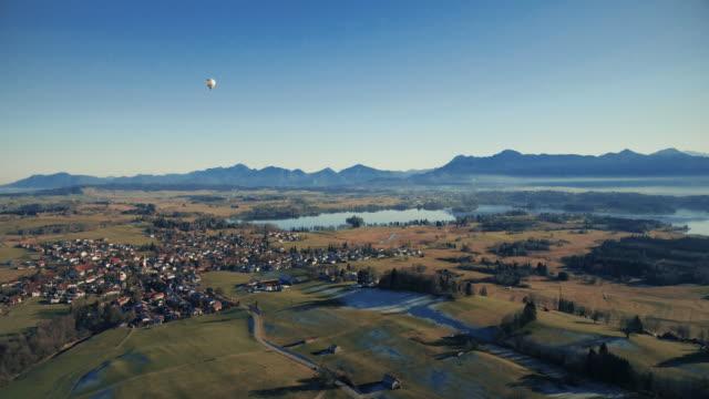 hot-air balloon flying at the bavarian alps - bavarian alps点の映像素材/bロール
