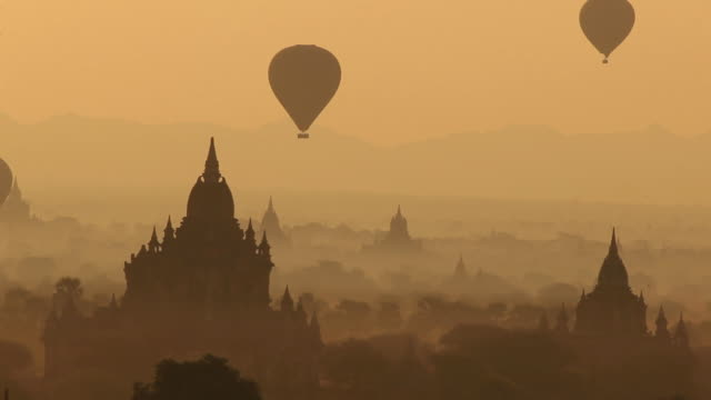 WS HA Hot-air balloons flying over ancient temples at sunrise / Bagan, Myanmar