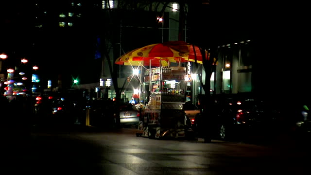 Hotdog stand at night in NYC USA