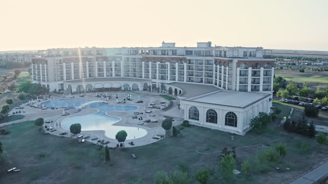hotel and golf resort in bulgaria with golf course - flying over it with a drone while sunset. - hotel stock videos & royalty-free footage