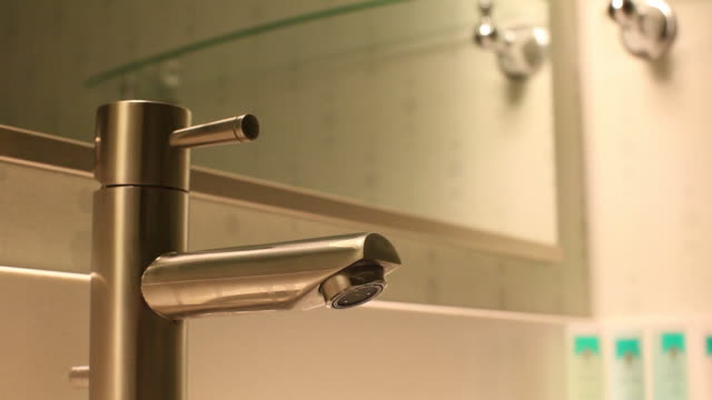cu tu td hotel bathroom sink faucet / wickenburg, arizona,usa  - bathroom sink stock videos & royalty-free footage