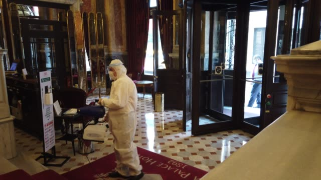 vidéos et rushes de hotel employee disinfects the lobby of istanbul's historic pera palace hotel on july 04, 2020 in istanbul, turkey. after being closed for more than... - museum