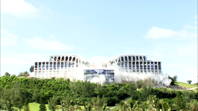 ws hotel in resort setting is demolished in controlled implosion using explosives / st. george's , bermuda - demolished stock videos & royalty-free footage