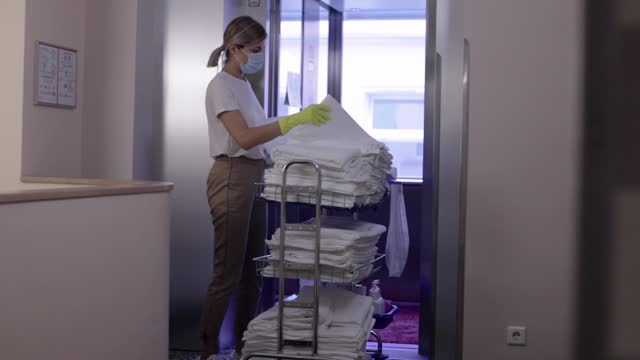 hotel maid carrying clean towels to rooms - hotel stock videos & royalty-free footage