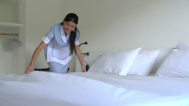 hotel maid making the bed - hotel stock videos & royalty-free footage