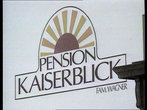 hotel owner accused of harassing guests with fawlty towers management style bnaf front of hotel run by erwin wagner lacms sign pension kaiserblick ms... - b rolle stock-videos und b-roll-filmmaterial