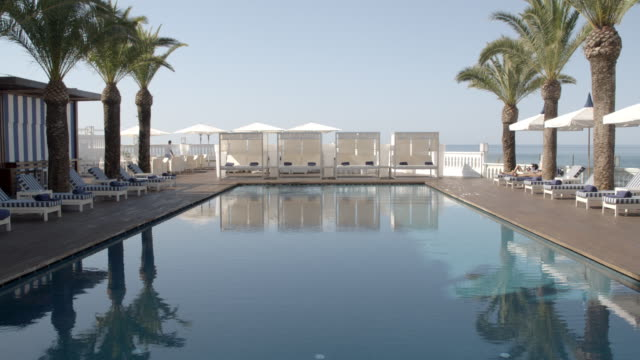 hotel poolside at day / algarve - poolside stock videos and b-roll footage