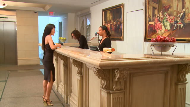 hd: hotel reception - receptionist stock videos and b-roll footage
