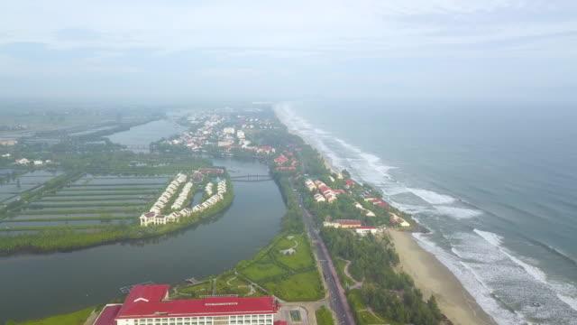 stockvideo's en b-roll-footage met hotel resort beside agricultural fields / vietnam - watervorm