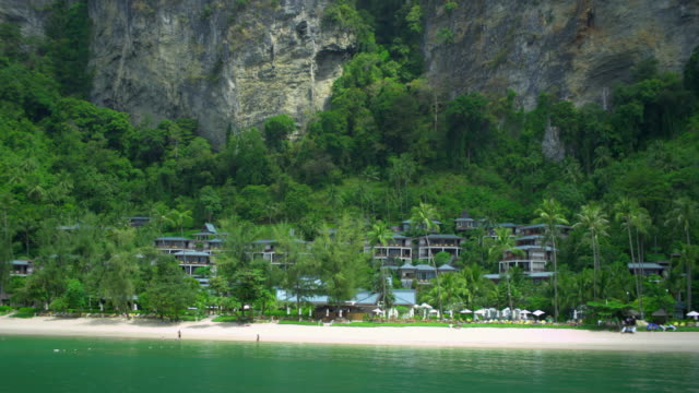 ws hotel resort on beach, limestone cliffs in background, krabi, thailand - see other clips from this shoot 1459 stock videos and b-roll footage