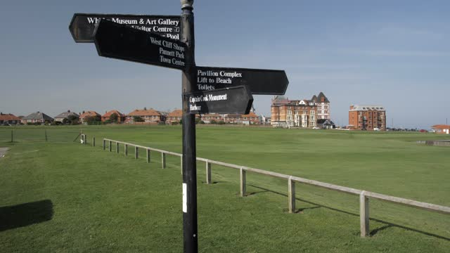 hotels and signpost at west cliff, whitby, north yorkshire, england, united kingdom, europe - directional sign stock videos & royalty-free footage