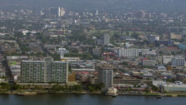 hotels line the coast of kingston, jamaica. - jamaica stock videos & royalty-free footage