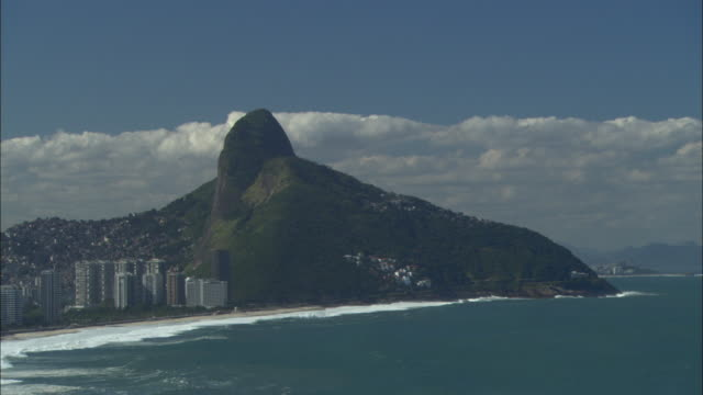 hotels line the coast of rio de janeiro below sugarloaf mountain. - stratocumulus stock videos and b-roll footage