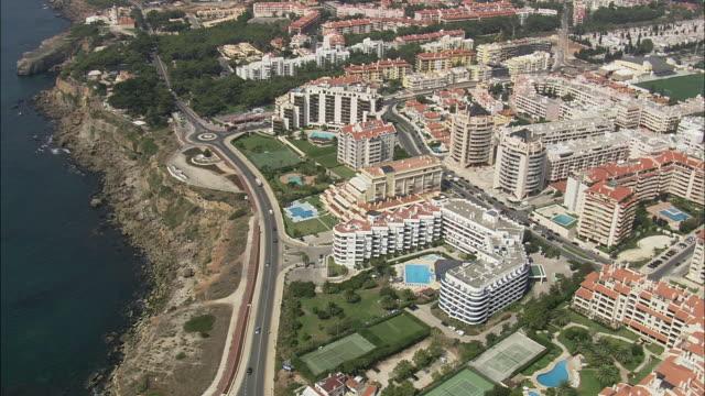 aerial ws hotels on high coast edge / cascais, lisbon, portugal - cascais stock videos and b-roll footage