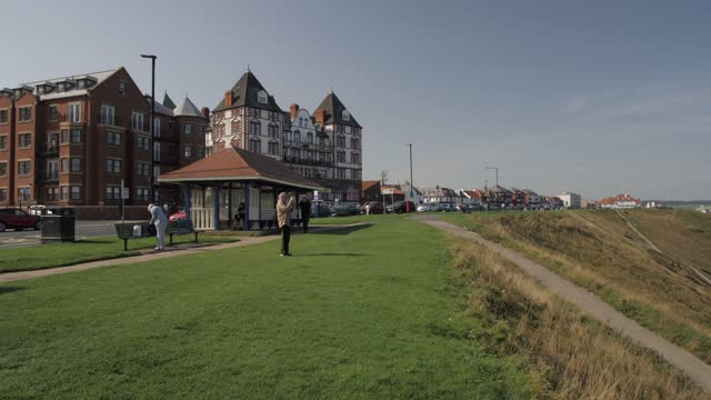 hotels, whitby beach and colourful beach huts from west cliff, whitby, north yorkshire, england, united kingdom, europe - shack stock videos & royalty-free footage