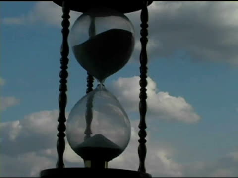 hour glass with clouds time lapse 3 - hourglass stock videos & royalty-free footage