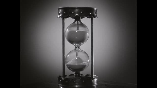 cu hourglass on table / united states - hourglass stock videos & royalty-free footage