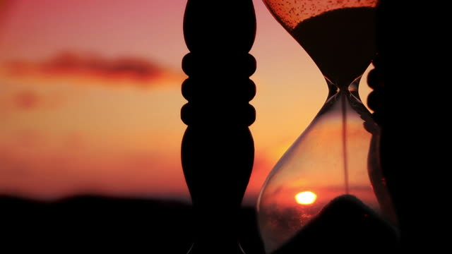 hourglass with cloud background - hourglass stock videos & royalty-free footage