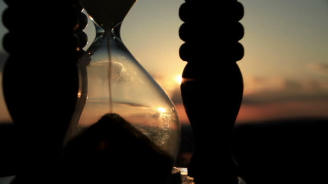 Hourglass  with Cloud Background