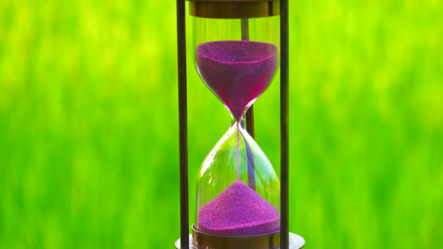 hourglass with green background - hourglass stock videos & royalty-free footage