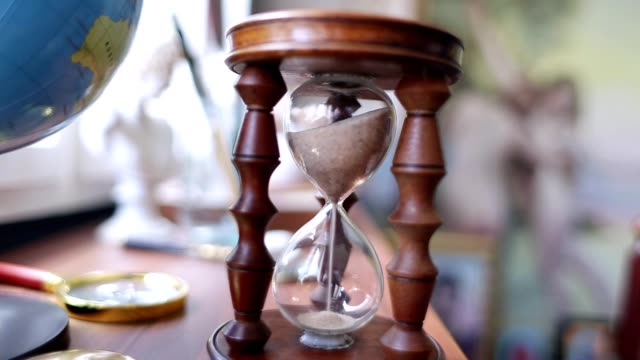 hourglass with sand on the table - turning stock videos & royalty-free footage