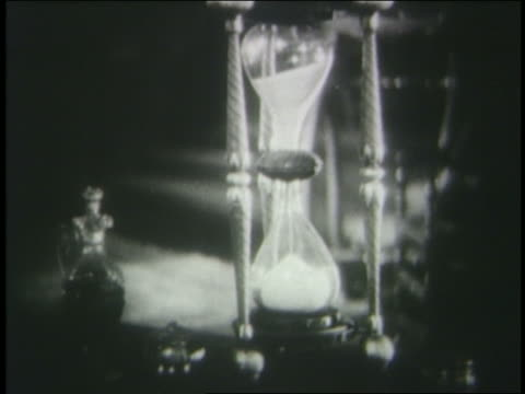 b/w 1925 hourglass with sand running thru it sitting on table - 1925 stock videos & royalty-free footage
