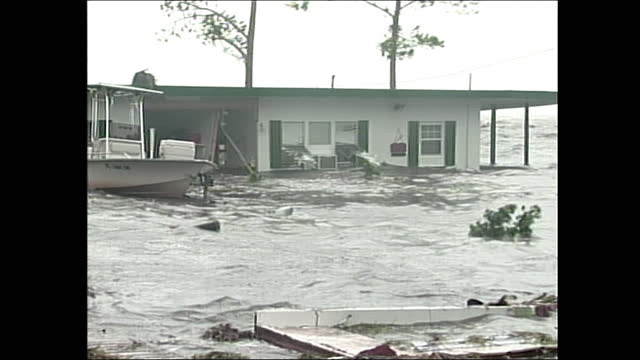 house and boat flooded during hurricane dennis. - environment or natural disaster or climate change or earthquake or hurricane or extreme weather or oil spill or volcano or tornado or flooding stock videos & royalty-free footage