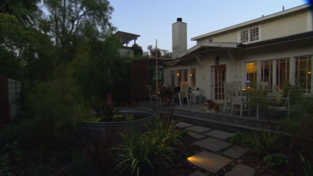 ms, pan, house and garden at dusk, dog lying on porch, venice, california, usa - stereotypically middle class stock videos & royalty-free footage