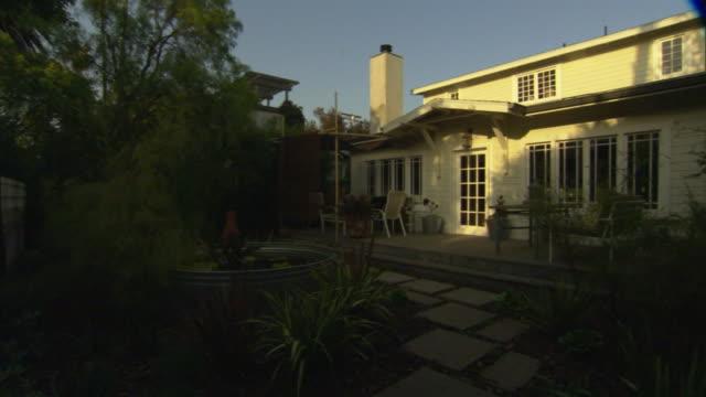 ms, pan, house and garden at sunset, venice, california, usa - veranda stock videos & royalty-free footage