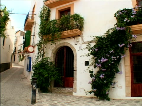 ms, house at cobblestone street, ibiza, spain - stationary process plate stock videos and b-roll footage
