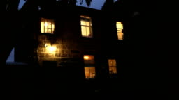 House At Night Lights Come On Man Comes Out