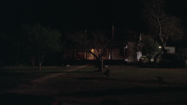 pov house at night with lights on / kaufman, texas, united states - kraneinstellung stock-videos und b-roll-filmmaterial