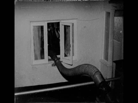 house being cleared of water after heavy flooding in bristol; 1970 - extreme weather stock videos & royalty-free footage