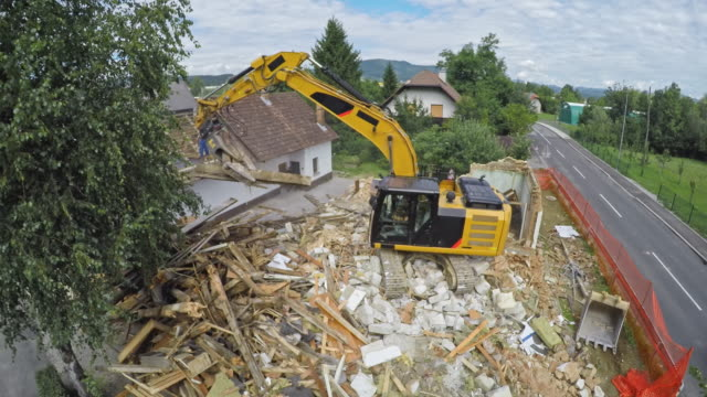 TIME LAPSE House being demolished by a large digger