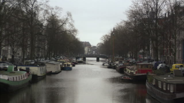WS, house boats moored along canal, Amsterdam, Netherlands