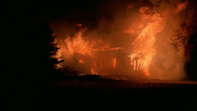 a house burns down in a raging inferno. - inferno stock videos & royalty-free footage