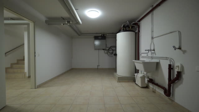 house cellar with heating system - heizung stock-videos und b-roll-filmmaterial