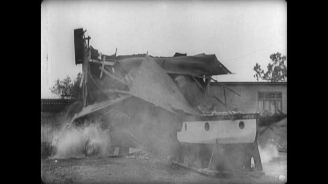 1921 house collapses as boat built inside it is towed outside by car - 1921 stock videos & royalty-free footage