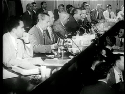 House Committee on UnAmerican Activities members seated at panel during trials / newsreel